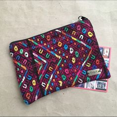 """Ketzali Recycled Textile Makeup Bag Tzuel make up / cosmetic bag Size: 7.5"""" x 5.5"""" Material Content: recycled textiles handmade in Guatemala Each bag is handmade in Guatemala with care, dedicated skill and is one of a kind! Ketzali Bags Cosmetic Bags & Cases"""