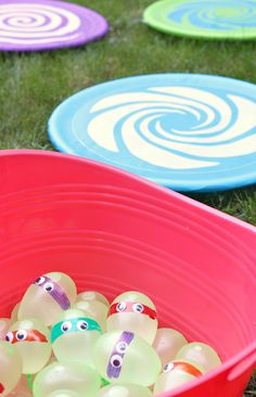 Use a sharpie to draw stripes across green balloons stick on google eyes to make TMNT water balloons! Kids can throw them at hula hoop targets in the yard for a fun backyard activity. Inspired by Teenage Mutant Ninja Turtles: Out of the Shadows, in theaters June 3rd. #ad