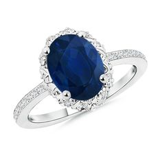 Love this Jewelry Style from Angara! Oval Blue Sapphire and Diamond Halo Ring