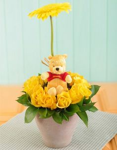 Buy or Send yellow rose and gerbera pottery arrangement with soft toy pooh bear in South Africa. | Item Code NETWP001