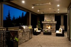 Besides being able to BBQ whenever you want, you can also cuddle up by this outdoor fireplace.