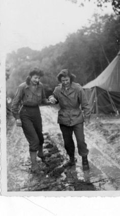 WACs of Army nurses finding their way through the mud ~