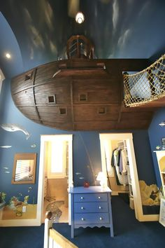"""The main feature of the room is the incredible floating pirate ship. Kuhl used 2x12 ribs to construct the hull of the ship, covering them with layers of 1/2 inch plywood to act as the planking. A bomb-proof blend of plaster and epoxy with integrated coloring was used simulate an old ship's hull."