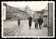 Kaunas, Lithuania, Jews walking in an unpaved street in the ghetto.