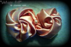peachy vintage wrap flower! i have completely fallen in love with them!! you can attach them to a hair clip, headband, elastic, or a pin!! they are $7.50! you can pick what print and color you want! the possibilities are endless! :))
