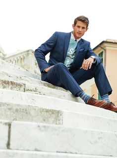 The formal collar & tie with an unformal sweater. Plus the socks.