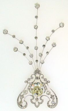 Stunning and versatile one-of-a-kind piece of jewelry - a necklace (two variations), a brooch (four variations) and a head-piece. It was created in France in the 1910's. The piece was made of platinum and set with a 6.29 cts cushion cut diamond in the center, Old European cut and rose cut diamonds.