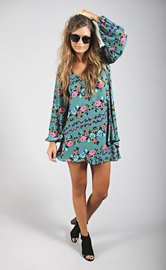 A Mumu floral garden is blooming this season. We are loving all the flower patterns. Donna Michelle Tunic isa top...it's a dress... it's both! You can pair it