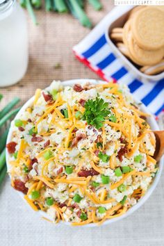 This sour cream and cheddar cheese variation is going to become a staple at all your backyard BBQs.  Get the recipe at Swanky Recipes.
