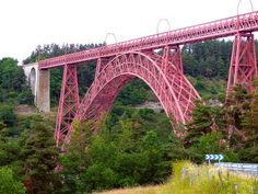 The Garabit Viaduct is a railway bridge and near the town of Ruynes en Margeride, France in the Cantal, which allows the line to Beziers Neussargues (or line of Causses) to cross the gorges of Truyère, tributary of the Lot. All metal, it was built by Gustave Eiffel & Cie company and completed in 1884, but the commissioning of the line did not take place until 1888.