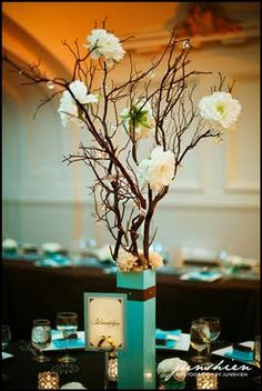 manzanita branch centerpieces and I accented them with the flowers around the base.