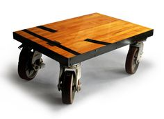"""Gym Floor Coffee Table. Beautiful repurposed basketball gym flooring sits on four 12"""" casters, making this piece a real show stopper. 72""""L x 48""""W x 18""""H"""