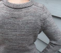 Ravelry: Stonehaven pattern by Laura Aylor. Lovely garter stitch detailing.