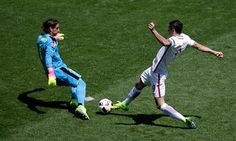 Switzerland goalkeeper Yann Sommer clears the ball ahead of Robert Lewandowski.