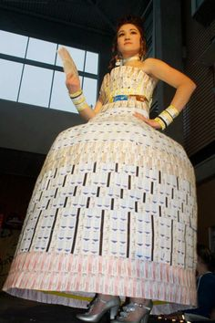 A dress made from 3,000 bus tickets and 6 hula hoops was the winning entry at the garbage fashion show. Now that's recycling!
