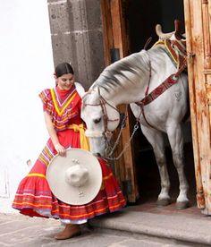 Mujer charra y su fiel caballo.