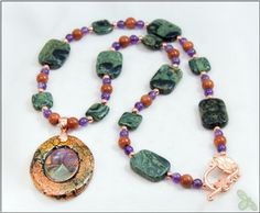 Handcrafted mixed-media floral pendant with gemstone adornments, including Amethyst and Kambaba Jasper. Available for sale here: http://www.zibbet.com/SterlingStarlingCreations/artwork?artworkId=1866666