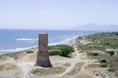 The Watch Tower next to Puerto Cabopino and the coast line beyond. Beach Holiday, Andalucia, Travel Guide, Beaches, Costa, Travel Destinations, Spain, Places To Visit, Tower