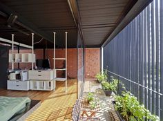 Image 8 of 13 from gallery of 36 BTrd / DP Architects. Courtesy of dp architects Dp Architects, Vertical Green Wall, Recycled Concrete, Passive Design, Boundary Walls, House In Nature, Street House, Construction Process, Indoor Air Quality