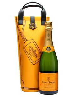 Veuve Clicquot Brut / Shopping Bag : Buy Online - The Whisky Exchange - A special edition of Veuve's classic Yellow Label champagne continuing their habit of packaging it up in something a bit more snazzy than a cardboard box - this time it's in a yellow shopping bag, ...