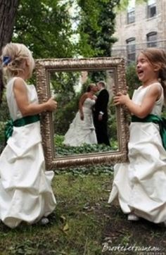 Cute!  The Best Man and Maid of Honor could hold the frame if kids aren't in the wedding!
