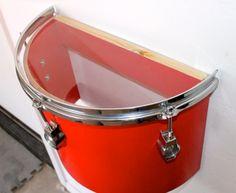 Drum cut in half to make a shelf
