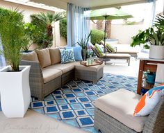 #FreshAmerican Mingled Turquoise and Trumpet Turquoise/Tangerine Indoor/Outdoor Pillows via @centsationalgrl's Creating an Outdoor Oasis: