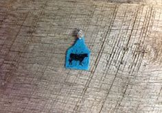Small Blue ear tag pendant with blue sparkles and black cow silhouette. Comes with rhinestone pinch bail. Repin to be entered to win one of four $50 gift certificates during our Five Year Anniversary Celebration in July 2014.
