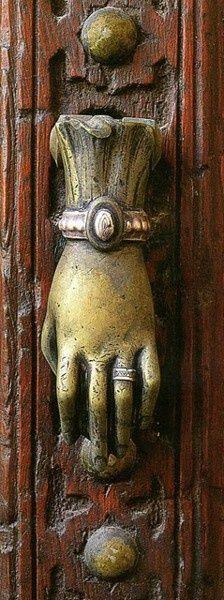 Bejeweled hand door knocker.