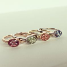 Silver and 14 kt golden rings with ashes. The ashes are mixed with a color. Which color would be your color of choice?