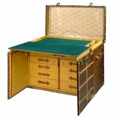 steamer trunk desk - one of 20 ever made and the most expensive LV trunk ever. Typical!