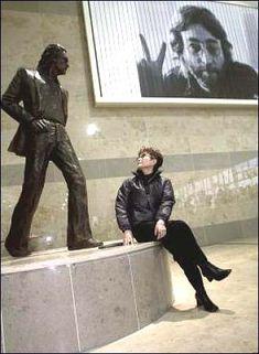 Yoko Ono admires the John Lennon statue at the John Lennon Liverpool Airport.