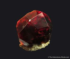 Spessartine Garnet, Shengus, Skardu, Gilgit, Pakistan, Thumbnail, 2.2 x 2.1 x 1.8 cm, Beautiful and lustrous, this Spessartine is a classic trapezohedron., For sale from The Arkenstone, www.iRocks.com. For more details on this piece and others, visit http://www.irocks.com/minerals/specimen/46194