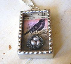 This handcrafted soldered shadowbox necklace features a tiny handmade rusted wire bird nest filled with soft pink fresh-water pearl eggs. The nest rests
