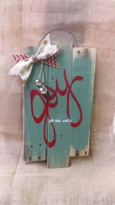 Joy to the world - pallet wall hanging - holiday pallet sign - hand painted sign - Christmas pallet sign - Seasonal pallet sign - wood sign by SkrappieHappie on Etsy https://www.etsy.com/listing/210478469/joy-to-the-world-pallet-wall-hanging