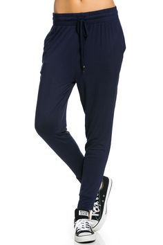 Super light weight navy jogger pants with adjustable drawstring and gold stopper detail. This super comfy jogger pants are perfect for indoors and out. Pair them with your favorite basic or graphic te