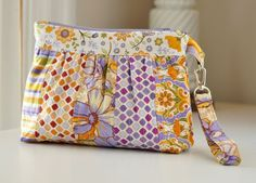 "An advanced beginner sewing pattern by Clover & Violet.  Fabric shown: ""Cold Spring Dreams"" by Mary McGuire for RJR Fabrics.  The Bella Clutch offers a removable wrist strap. If the hardware is not available to you, the strap can of course be attached directly to the Bella Clutch Bag.  This is a really sweet bag. Go to the Bella Clutch Bag Pattern  Advertisement  The Stitcher's Dream Bag + the Itty Bitty Pouch  More quilted bags to sew:  Quilted Knapsack Quilted Wristlet Quilted Ironing…"