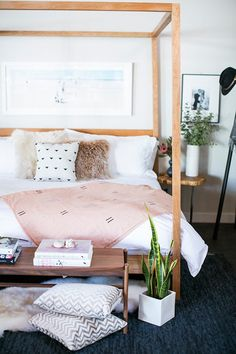 The blushing pink accent to this room adds the perfect amount of color for a dreamy and relaxing space.