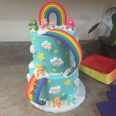 - Care Bear cake made for my best friend's little girl who turned 2. The little Care Bears are little vending machine toys. I didn't have time to make them out of fondant. I made the inside of the top tier rainbow as well to match.