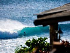 Photo: A surfer rides a wave in Bukit Badung Peninsula, Bali