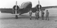 """Germans inspecting captured at the air base of Sola Norwegian bomber Caproni CA-310 """"Libeccio"""", one of four purchased by the Norwegians in Italy in 1938."""