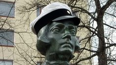 Elias Lönnrot statue in Kajaani, wearing student cap on Mayday 2012.    Elias Lönnrot lived in 19th century and did very important work for the finnish language. He also gathered the poems of Kalevala, the finnish national epic.