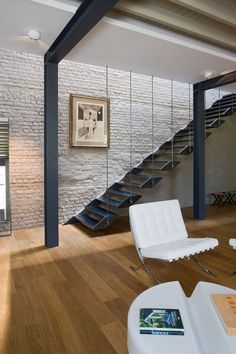 semi suspended staircase. Franken House by Bekhor Architecte in Brussels