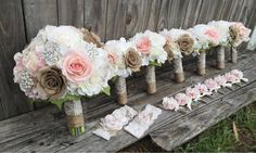 """Custom Ordered Bridal Package This gorgeous set will be going out to a bride having an elegant, rustic country wedding with beautiful blush & ivory roses, burlap roses, and ivory hydrangeas accented with baby's breath, pearls, and lace. (1) 10"""" Bridal Bouquet (5) 6"""" Bridesmaids Bouquets (1) Toss Bouquet (8) Bridal party boutonnières (1) Garter Set Cake cluster flowers"""