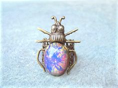 Vintage Arlequin Glass Steampunk Beetle Ring by aevalillithjewelry, $36.00