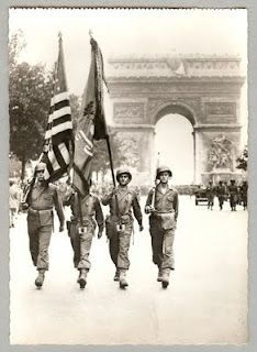 Paris, 1944.  American troops marched down the Champs Elysees in Paris liberating the French capital from Nazi control.