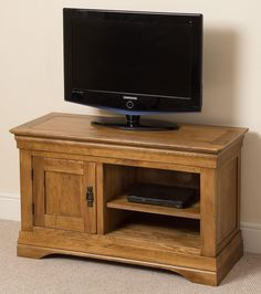 French Chateau Rustic Solid Oak Small TV Cabinet Crafted by skilled joiners from solid oak, the French rustic TV cabinet offers a compact and stylish solution to display your TV, DVD and related appliances. Small Tv Cabinet, Oak Tv Cabinet, Glass Cabinet Doors, Tv Cabinets, Living Room Wall Units, Living Room Furniture, Small Tv Unit, The Unit, Small Corner Tv Stand