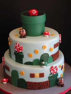 Super Mario Brothers Birthday Cake - This Super Mario Brothers cake was for a little boy turning 5. Everything is edible.