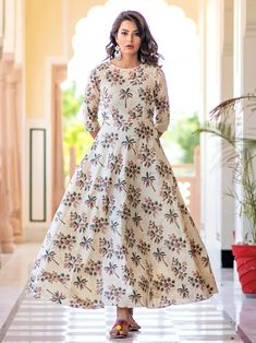 Charming cream maslin digital printed gown online available at Inddus.com. Shop this alluring gown for upcoming parties and grand events. Indian Dresses For Girls, Girls Dresses, Gown Suit, Lehenga Style, Printed Gowns, Gowns Online, Western Dresses, Indian Ethnic Wear, Designer Gowns