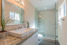 Contemporary 3/4 Bathroom with Large Ceramic Tile, European Cabinets, Flush, frameless showerdoor, Complex granite counters